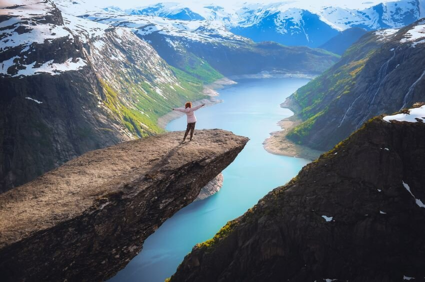 Woman on mountain top feeling complete bliss.