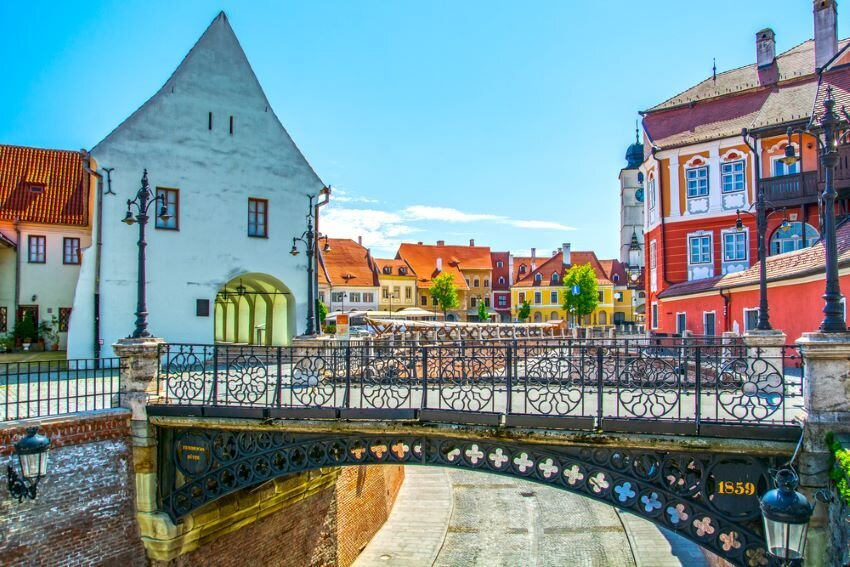 Sibiu, Transylvania, Romania, the Liars Bridge and view of Small Square and Council Tower.