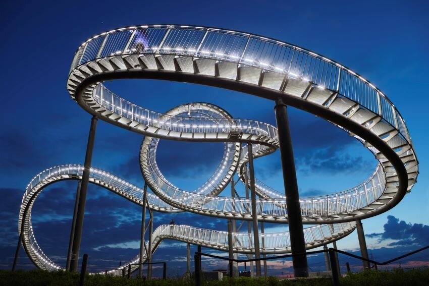 Tiger and Turtle - Magic Mountain lite up at night.