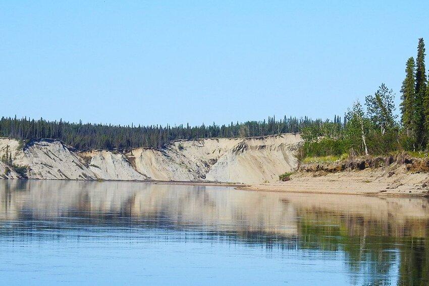 Kobuk River in Kobuk Valley National Park in Alaska with sand dunes in the distance.