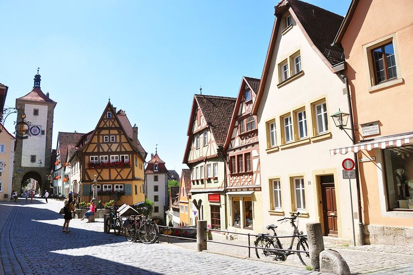 View of Herrngasse in Rothenburg Germany with tourists.