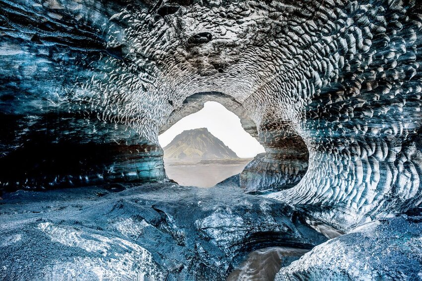 Blue crystal ice cave, underground beneath the glacier in Iceland, Europe.