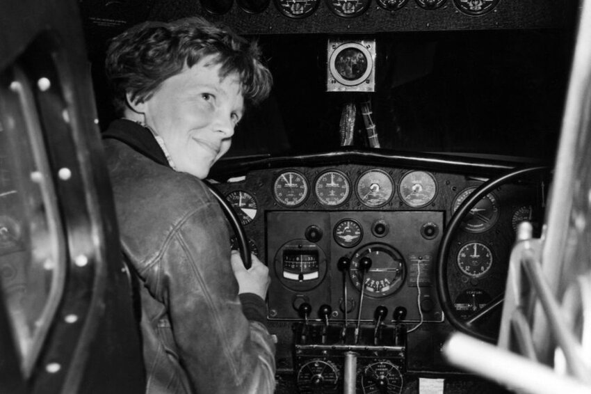 Amelia Earhart in her Lockheed L- 10E Electra prepares for 27,000 mile globe flight.