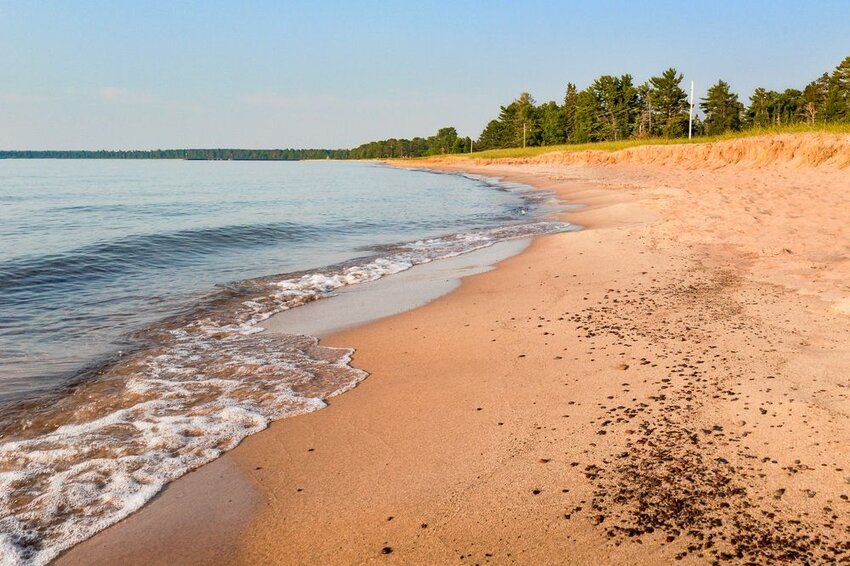 Bete Grise Bay flows into Lake Superior, near Bete Grise, Michigan.
