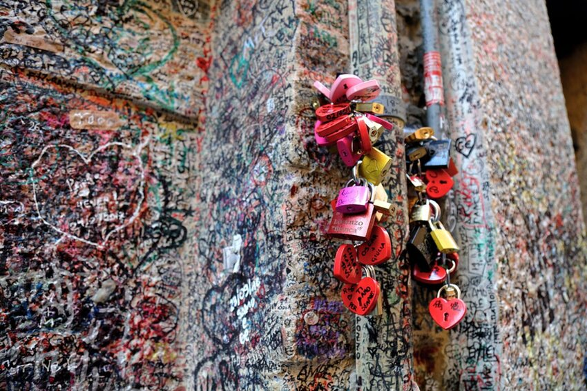 Outside Juliet's House in Italy filled with love notes and locks.