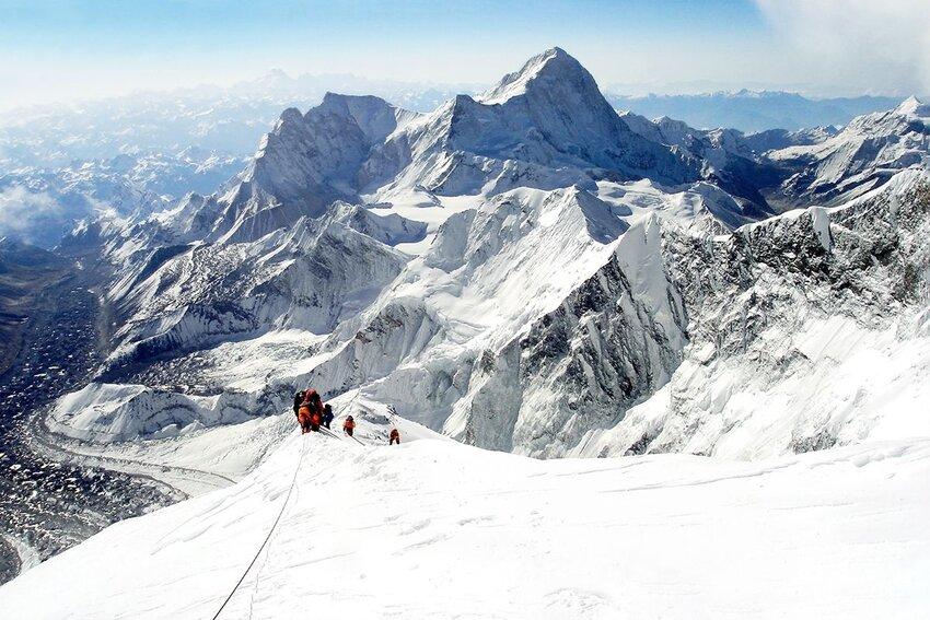 Mountaineers climbing Everest.